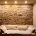Slate stone wall with couch Royalty Free Stock Photo