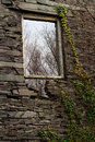 Slate window frame the in the gable end of what was the main mill at the dorothea quarry this is in nantlle gwynedd wales united Stock Photo