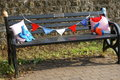 Slatted black bench womens institute yarn bombing bestwood village decorating the trees and gates and hedges and benches at Stock Photography
