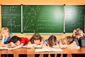 Sleaping tales group of tired school children at a classroom education Stock Images