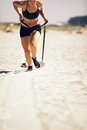 Sled pull female crossfitter pulling a on sand during crossfit workout Royalty Free Stock Photo