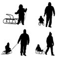 Sledding silhouettes parents with children Royalty Free Stock Photography