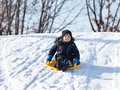 Sledding at winter time Royalty Free Stock Image