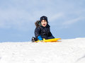 Sledding at winter time Royalty Free Stock Photo