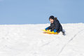 Sledding at winter time Stock Image