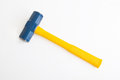 Sledge hammer a blue and yellow isolated on white Royalty Free Stock Image