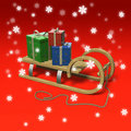 Sledge with presents and snow. Royalty Free Stock Images