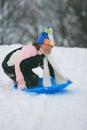 Sledride sideways little girl having fun sledding Stock Images