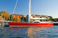 Sleek, red oceangoing sailboat