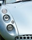 Sleek sports car details of the headlights fender and front of a stylish Royalty Free Stock Photos