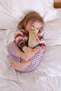 Sleep rituals toddler girl getting ready to having her drink before fall asleep Royalty Free Stock Photos