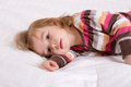 Sleep time toddler girl cannot keep her head up perhaps her passed Stock Image