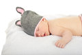 Sleeping baby with bunny cap slereping knitted isolated on white background Stock Photo