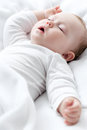 Sleeping baby carefree little on a bed Royalty Free Stock Photography