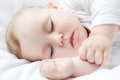 Sleeping baby carefree little on a bed Stock Photos