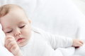 Sleeping baby carefree little on a bed Stock Image