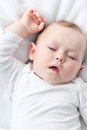 Sleeping baby carefree little on a bed Stock Photo