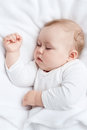 Sleeping baby carefree little on a bed Royalty Free Stock Image