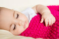 Sleeping baby covered with knitted blanket closeup portrait of Royalty Free Stock Photo