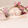 Sleeping baby girl in flowers, beautiful vintage background Royalty Free Stock Photo