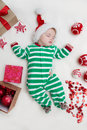 Sleeping baby girl Santa Claus. Royalty Free Stock Photo