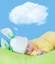 Sleeping baby in hare or rabbit hat Royalty Free Stock Photo