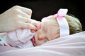Sleeping baby holding parent hand newborn close up Royalty Free Stock Photo