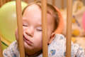 Sleeping baby sleeps with funny face in the playpen Stock Photos