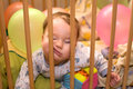 Sleeping baby sleeps in the playpen with his face between the bars Royalty Free Stock Photos