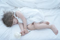 Sleeping beauty baby girl in white bed Royalty Free Stock Photography