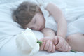 Sleeping beauty baby girl in white bed Stock Image