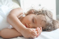 Sleeping beauty baby girl in white bed Royalty Free Stock Image