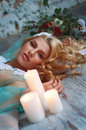 Sleeping beauty. Young blond woman on the floor. Royalty Free Stock Photo