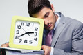Sleeping businessman holding folders and clock portrait of a over gray background Stock Photo