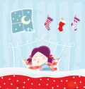Sleeping child during christmas night Stock Photos