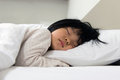 Sleeping child portrait of asian on the bed Royalty Free Stock Images