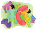 Sleeping children twins cute two are in an array of pillows and toys different positions upper view Royalty Free Stock Image