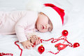 Sleeping christmas baby girl santa claus Stock Photography