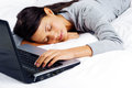 Sleeping on computer woman Royalty Free Stock Photo