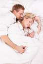 Sleeping couple happy lying in bed Royalty Free Stock Photography