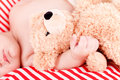 Sleeping cute little baby on red and white stripes pillow Royalty Free Stock Photos