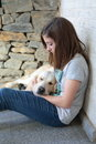 He is sleeping girl with her dog in her arms Royalty Free Stock Photo