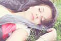 Sleeping girl tinted young beautiful and green grass Stock Images