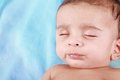 Sleeping Indian Baby Boy with blue background Stock Images