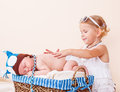 Sleeping infant elder sister taking care of a Royalty Free Stock Images