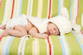 Sleeping little easter newborn baby with bunny hat Royalty Free Stock Photos