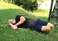 Sleeping man young and having rest on a meadow Royalty Free Stock Photo
