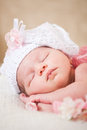 Sleeping newborn baby at the age of days sleeps in a knitted hat Stock Images
