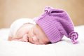 Sleeping newborn baby at the age of days sleeps in a knitted hat Royalty Free Stock Photo