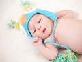 Sleeping newborn baby at the age of days sleeps in a knitted hat Royalty Free Stock Image